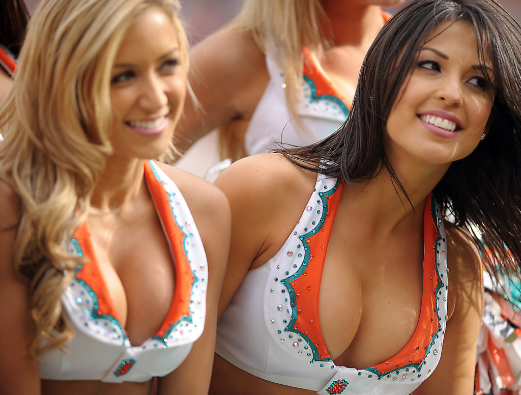 Jan. 03, 2010 - miami gardens, Florida, USA - Miami Gardens ---finsrd03g---Miami Dolphins host the Pittsburgh Steelers at Land Shark Stadium. Two Dolphin cheerleaders get together for a photo Sunday afternoon.     Robert Duyos,  Sun Sentinel  (Credit Image: © Sun-Sentinel/ZUMApress.com)